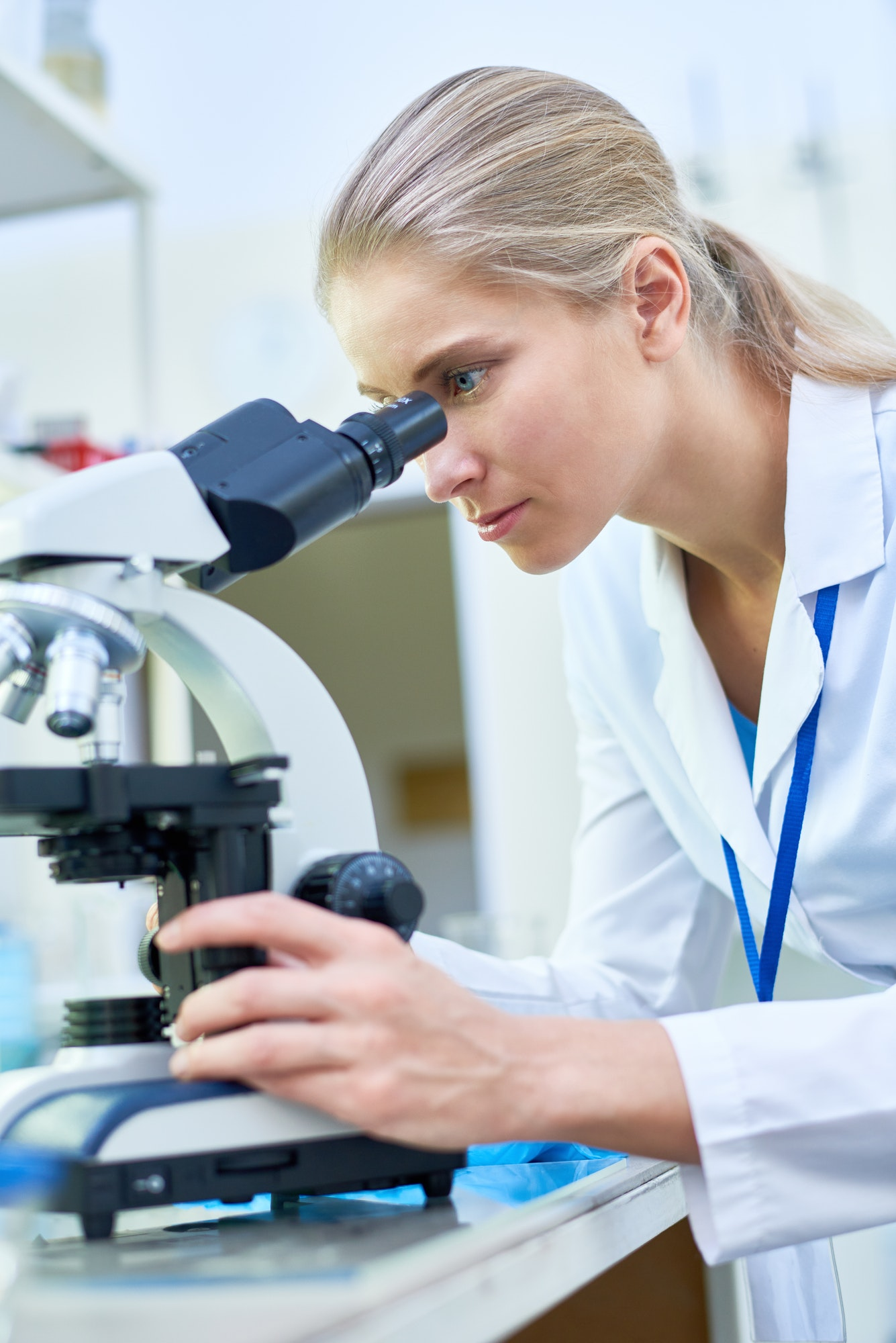 Female Scientist Using Microscope