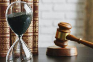 Hourglass And Gavel On Table